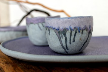 Smalvivid violet pinchpots on a plate